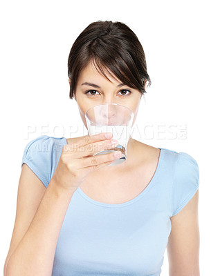 Buy stock photo Portrait of a cute young lady drinking milk on white background