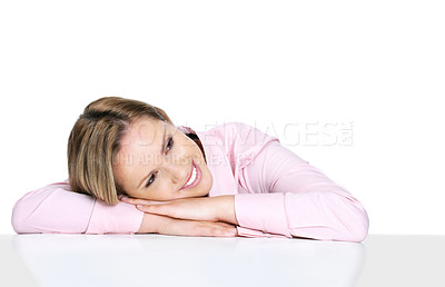 Buy stock photo Beautiful young woman leaning on a table while looking at copyspace
