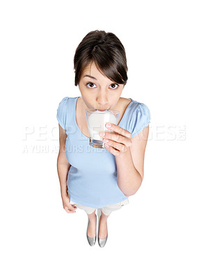 Buy stock photo Top view of a young lady drinking milk on white background