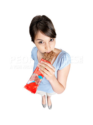 Buy stock photo Top view of a pretty young female eating a chocolate on white background