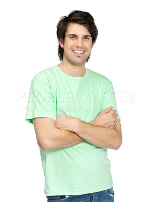 Buy stock photo Portrait of a confident young guy standing with folded hands on white background