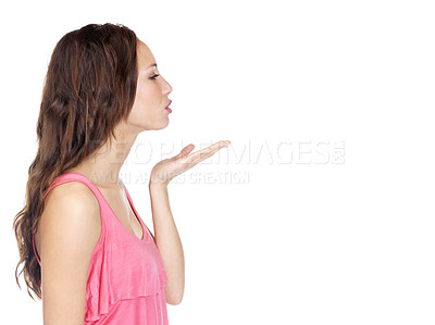 Buy stock photo Profile inage of a cute young lady blowing kiss on on white background