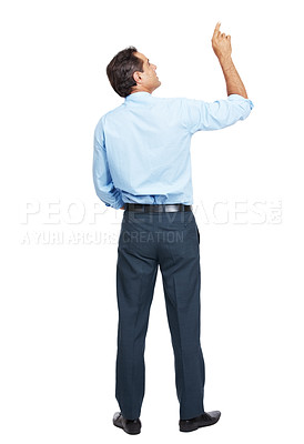 Buy stock photo Rearview shot of a businessman pointing at copyspace  against a white background