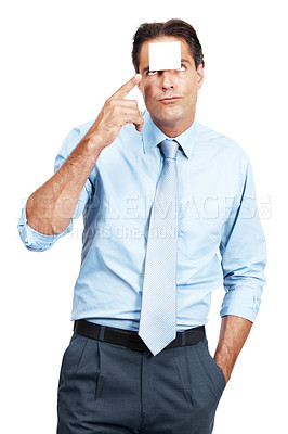 Buy stock photo Studio shot of a businessman pointing to a sticky note on his forehead