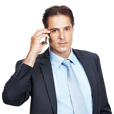 Buy stock photo Portrait of a serious business man using a mobile phone against a white background