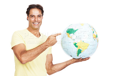 Buy stock photo Portrait of a man pointing at the globe he's holding against a white background