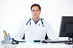 Confident doctor sitting at his office desk