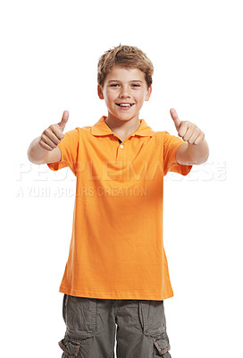 Buy stock photo Portrait of a smilling cute little boy gesturing thumbs up sign agaist white background