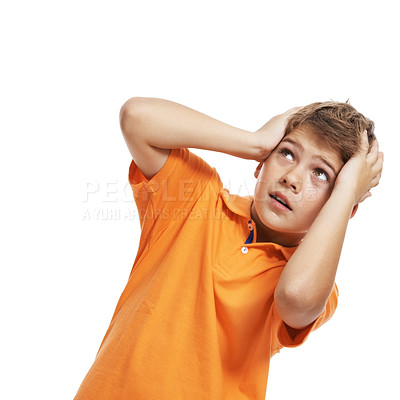 Buy stock photo Portrait of a cute little boy scared with his hands on head looking upwards against white background