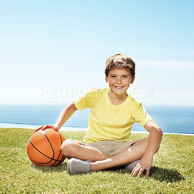 Buy stock photo Portrait of cute little boy sitting on grass with a basketball  - Summer holidays