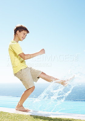 Buy stock photo Portrait of happy little kid splashing the water by leg at the pool - Outdoors