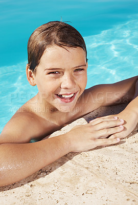 Buy stock photo Happy little boy leaning on the side of a swimming pool - Enjoying holidays