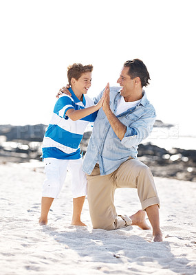 Buy stock photo Happy father and son enjoying their summer vacation on the beach