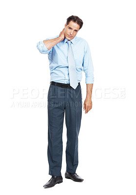 Buy stock photo Portrait of a businessman suffering from neck pain standing against a white background