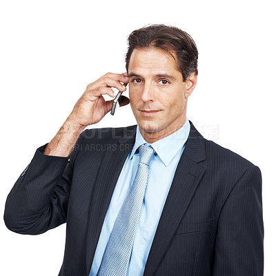 Buy stock photo Shot of a mature businessman talking on his cellphone against a white background