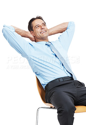 Buy stock photo Studio shot of a mature businessman sitting on a chair with his hands behind his head