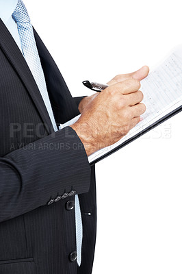 Buy stock photo Cropped image of a businessman writing something on a clipboard against a white background