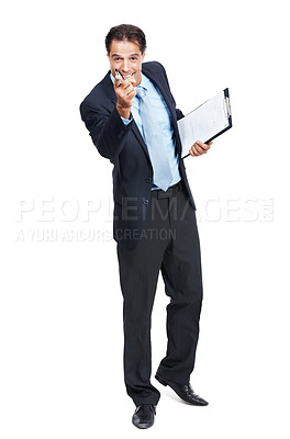 Buy stock photo Shot of businessman holding a clipboard pointing at the camera isolated on white