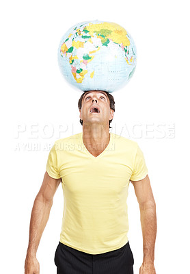 Buy stock photo Shot of a man balancing a globe on top of his head against a white background