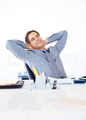 Buy stock photo Portrait of relaxed business man sitting at his desk and thinking about something