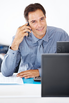 Buy stock photo Portrait of confident business executive using mobile phone while at work