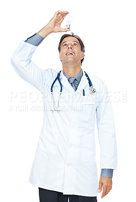 Buy stock photo Happy mature doctor holding a electric bulb above his head isolated on white background