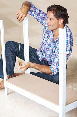 Buy stock photo Manual worker measuring the metal bars with tape measure in workshop