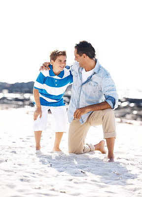 Buy stock photo Portrait of a happy sweet small boy and his father looking at each other at the sea shore