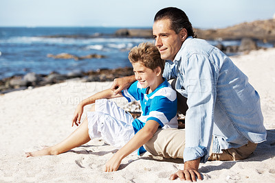 Buy stock photo Portrait of caring father and his kid sitting on the beach and looking away at copy space
