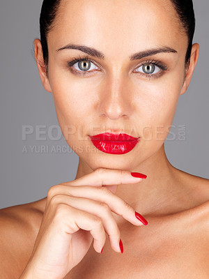 Buy stock photo Closeup portrait of a pretty young girl posing confidently against grey background