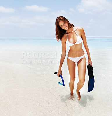 Buy stock photo Shot of a young woman at the beach with her snorkeling gear
