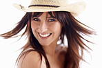 Portrait of a happy female wearing a straw hat on white