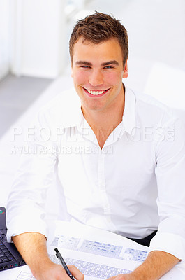 Buy stock photo Cropped shot of a young businessman working in his office