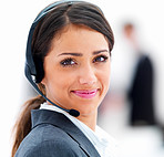 Closeup of a smiling business woman with headphones