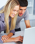 Young couple using a laptop together