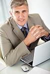 Relaxed mature business man with a laptop at office