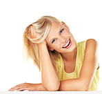 Relaxed young woman smiling against white