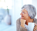 Thoughtful senior woman holding a cup of coffee