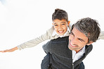Mature man piggybacking his son over white with copyspace