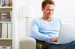 Modern Young man working on laptop at home