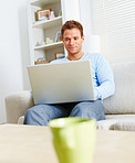 Modern lifestyle - Fresh young man using laptop