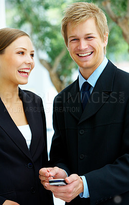 Buy stock photo Cropped shot of two colleagues doing business outdoors