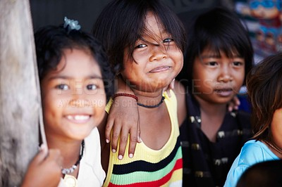 Buy stock photo Portrait of cute little kids from rural Thailand laughing