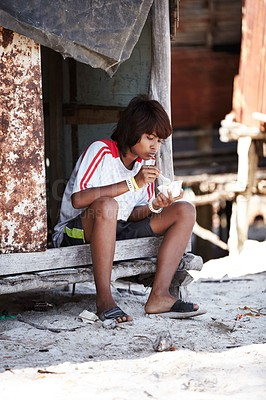 Buy stock photo Portrait of a young rural girl from Thailand eating her meal
