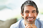 Closeup of a charming mature man smiling with copyspace