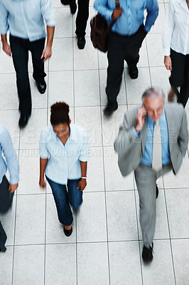 Buy stock photo Top view of multi ethnic business executives walking on tiled floor