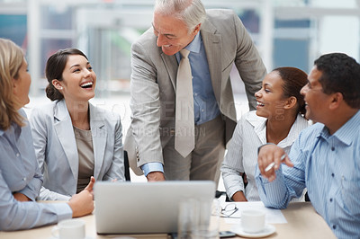 Buy stock photo Portrait of senior business man discussing a new project at office on laptop