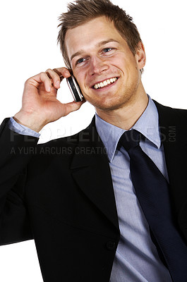 Buy stock photo Businessman Making a Call - A trendy businessman with a blue tie and shirt.