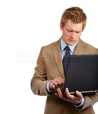 Buy stock photo WHATS WRONG WITH MY LAPTOP!! Frustrated young man having problems while working.
