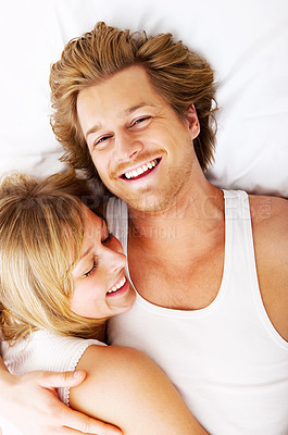 Buy stock photo Young couple playing in bed. A sensual and cute couple.